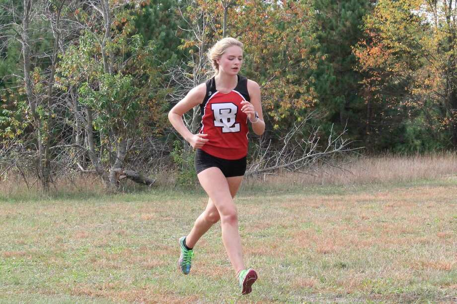 Bella Leffew races down the final straightaway during a home meet on Sept. 26. (File photo)