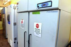 The two freezers awaiting the COVID-19 vaccines from Pfizer and Moderna at Yale New Haven Hospital on December 11, 2020. The freezer at right can store around 100,000 doses of the Moderna vaccine down to a temperature of -25° centigrade and the freezer next to it is capable of storing around 150,000 doses of the Pfizer vaccine down to a temperature of -90° centigrade.