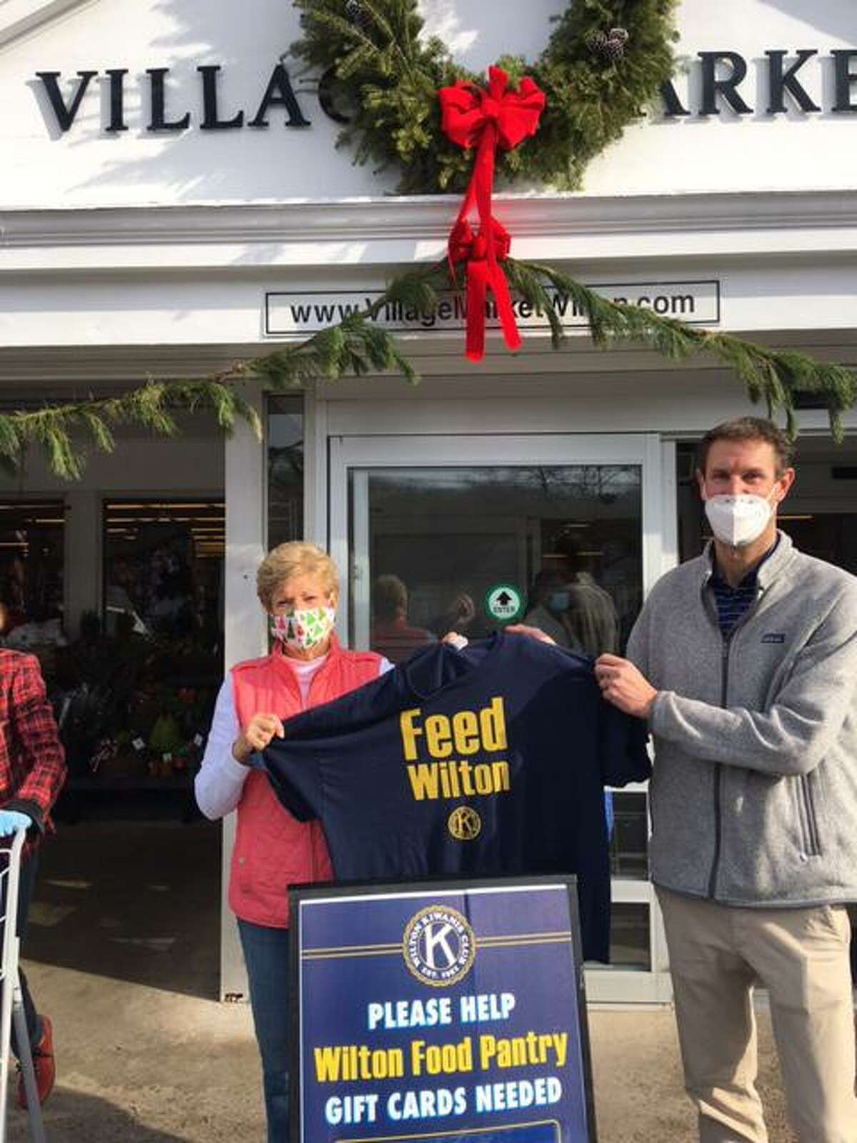 Kiwanis Vice President Carol Boehly and Village Market co-owner Tim Dolnier stand outside the market on Dec. 13, following a successful fundraiser for Wilton's food pantry.