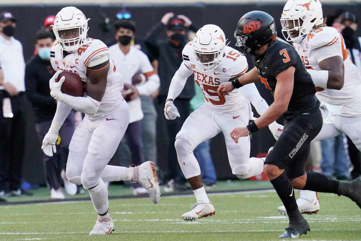 Texas' Joseph Ossai is pursued by Oklahoma State safety Tre Sterling (3) during an NCAA college football game in Stillwater, Okla., Saturday, Oct. 31, 2020. (AP Photo/Sue Ogrocki)