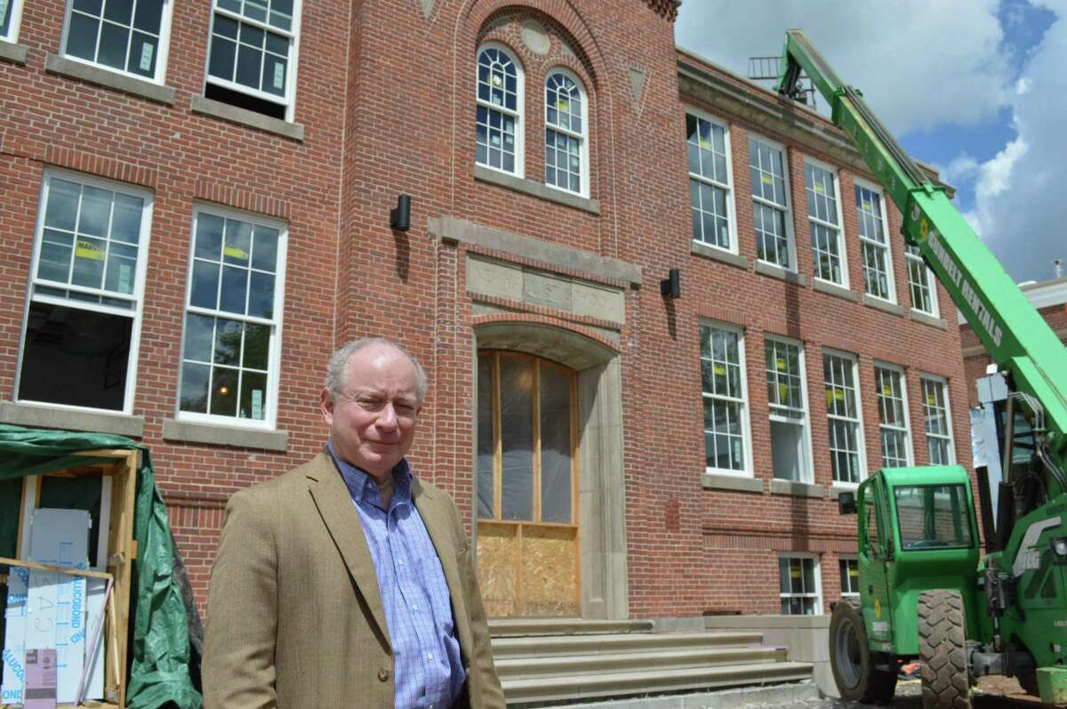 Dale Kroop in front of the Hamden Business Incubator under construction readying to welcome small business start-ups.