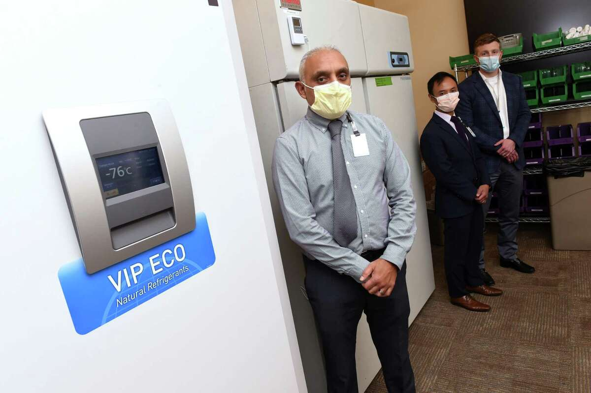 From left, Nilesh Amin, supervisor of Pharmacy Procurement and Operations for Yale New Haven Health System, Eric Cabie, operations manager for Smilow Cancer Hospital Pharmacy, and Daniel Kilcoyne, operations manager for Yale New Haven Hospital, are photographed by the two freezers awaiting the COVID-19 vaccines from Pfizer and Moderna at Yale New Haven Hospital on December 11, 2020.