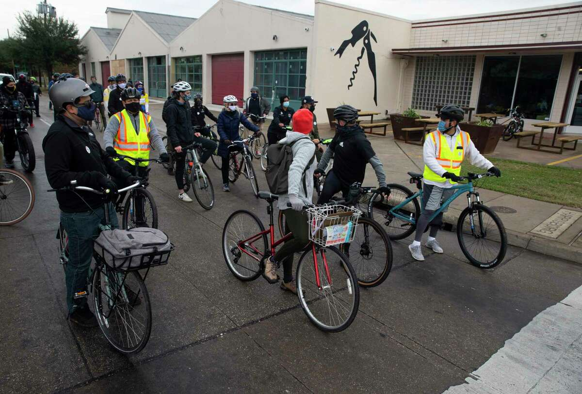 Houston City and Harris County officials and bike community members wait for a traffic light at Sampson Street and Harrisburg Boulevard and learn about the business development in the neighborhood during a bike ride tour Saturday, Dec. 5, 2020, at East End in Houston. The East End Bike Plan, which covers the 16 square miles of the East End District boundaries, will identify bike route improvements in the area based on the community's feedback. Development of this Plan is expected to be completed in 2021.
