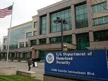 (FILES) In this file photo taken on March 3, 2020, Evegnii Nessirio of Seattle, a Russian citizen who was scheduled for his citizenship interview, stands outside following a two-week closure of a Department of Homeland Security (DHS) building and US Citizenship and Immigration Services (USCIS) field office because of an employee who may be infected with the novel coronavirus in Tukwila, Washington. - The US Department of Homeland Security reportedly became the third federal department to be targeted by hackers, US media reported on December 14, 2020 a day after Washington revealed a major cyberattack which may have been coordinated by a foreign government. (Photo by Jason Redmond / AFP) (Photo by JASON REDMOND/AFP via Getty Images)