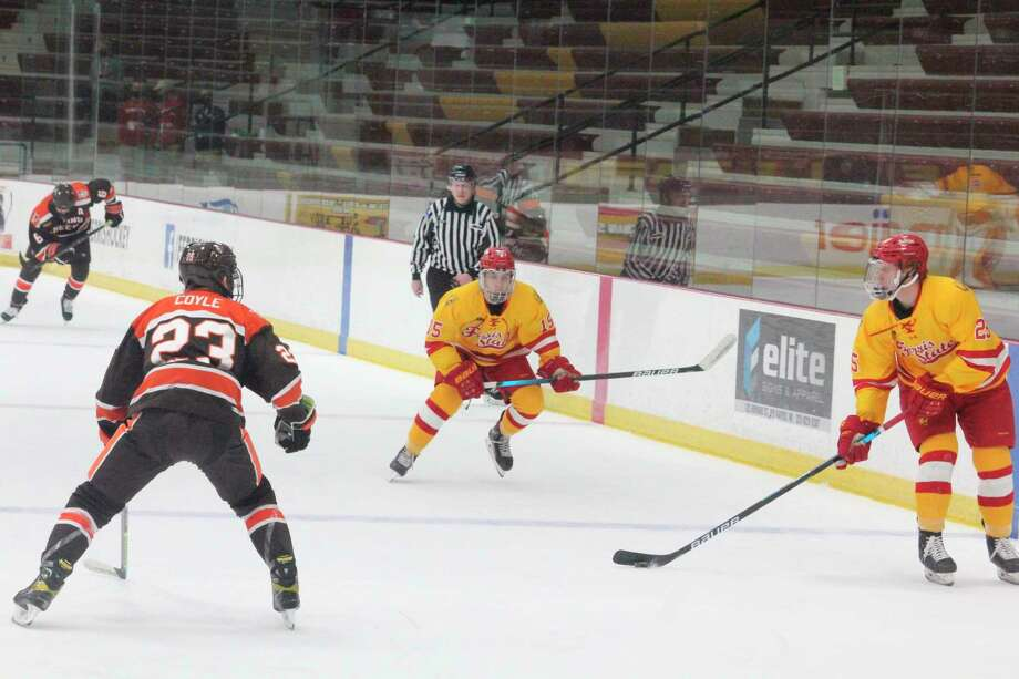Ferris' Jake WIllets (25), trailed by teammate Jake Transit (15), looks to make a play against Bowling Green's Max Coyle (23) in Saturday's game at the Ewigleben Ice Arena. (Pioneer photo/John Raffel)
