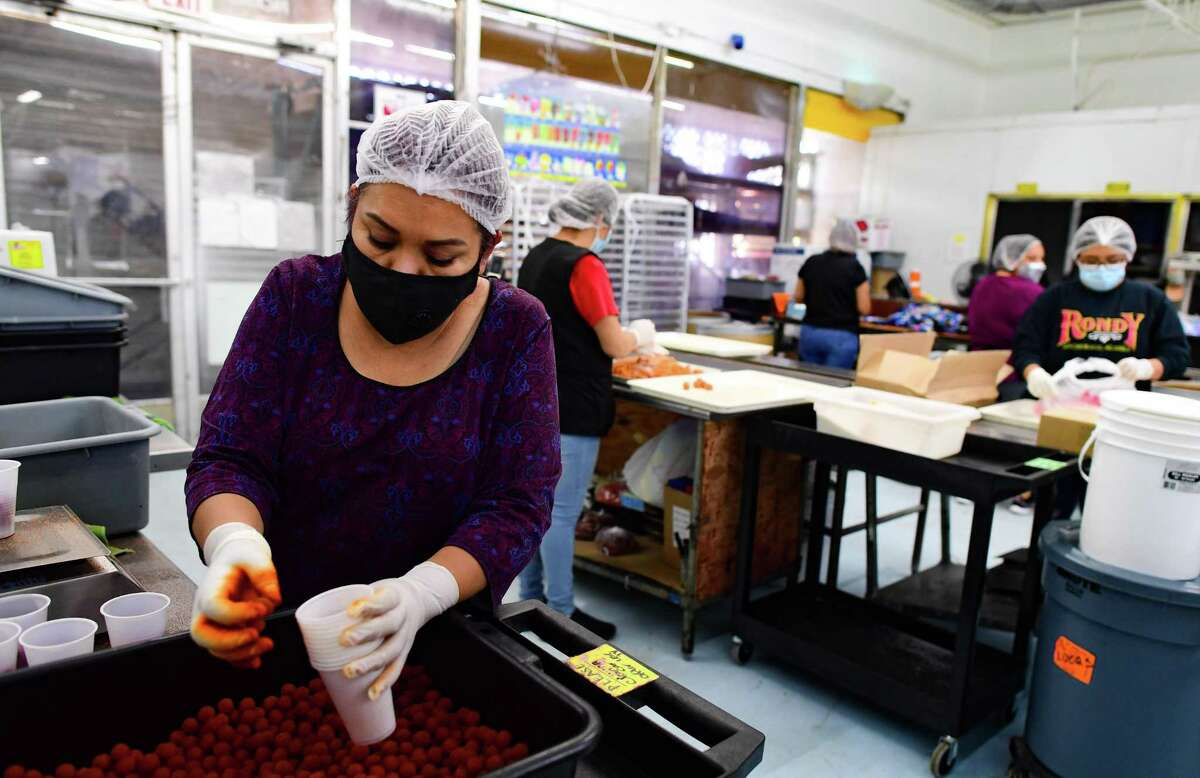 A worker packs spicy candy at Alamo Candy Co.