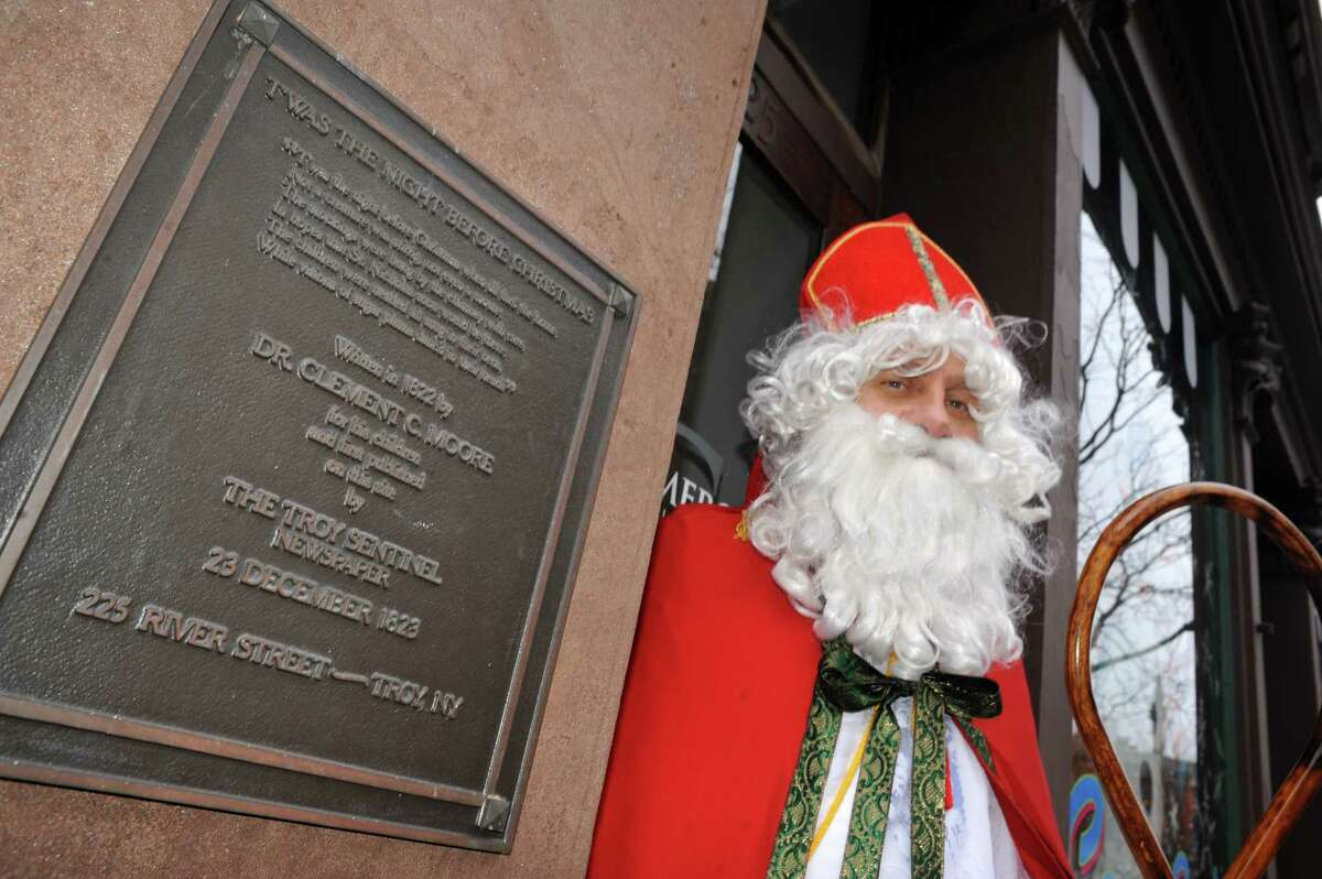 Sinterklass, aka St. Nicholas Karl Felsen, stands outside the historic former Troy Sentinel newspaper building at 225 River St. on Dec. 19, 2014, near the plaque that commemorates