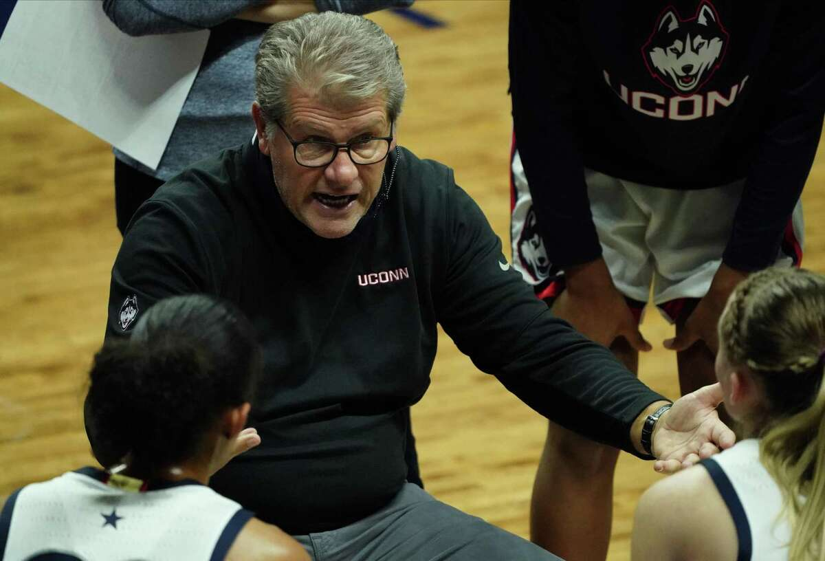 Dec 12, 2020; Storrs, Connecticut, USA; Connecticut Huskies head coach Geno Auriemma talks to his players during a break in the action as they take on the Massachusetts Lowell River Hawks in the second half at Harry A. Gampel Pavilion. UConn defeated Massachusetts Lowell 79-23. Mandatory Credit: David Butler II-USA TODAY Sports
