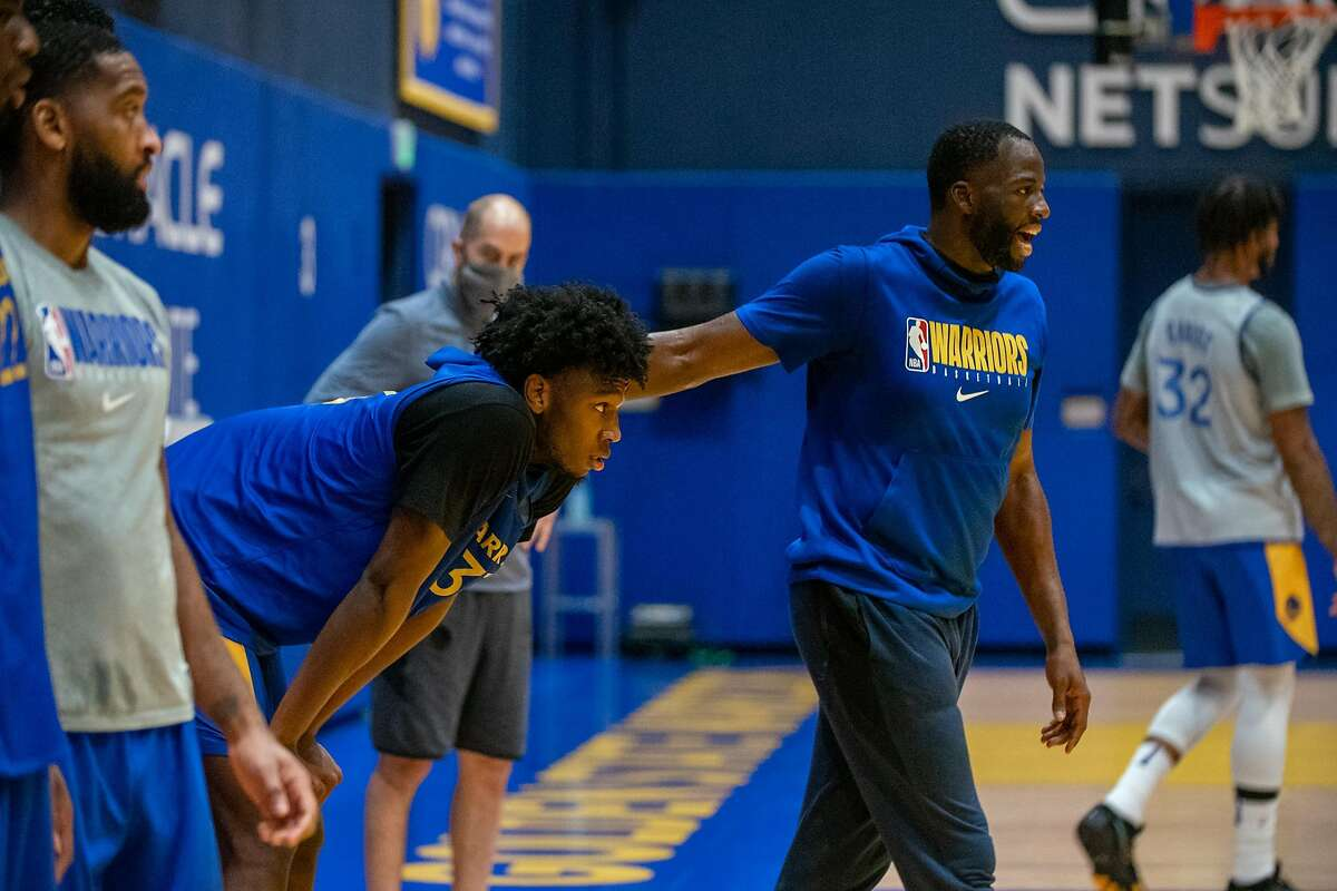 Draymond Green, right, with James Wiseman during a Golden State Warriors practice at the Chase Center in San Francisco on Monday, December 14, 2020.