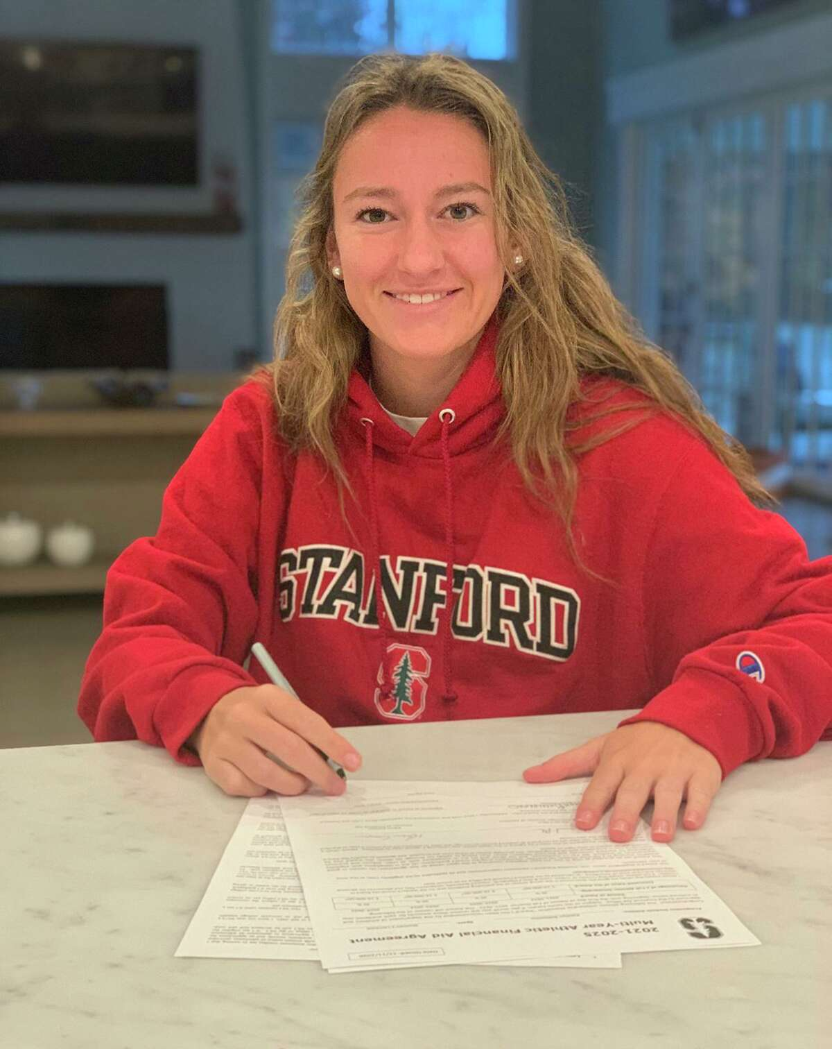 Darien senior Kate Bellissimo signs her National Letter of Intent to Stanford lacrosse on Nov. 11.