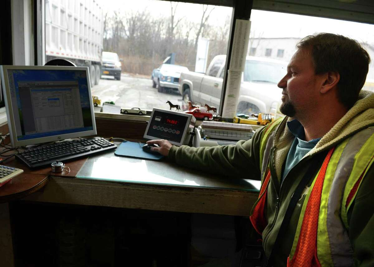 Rick Bednar weighs a full trailer of waste Thursday, Jan. 15, 2015, at the Trumbull Recycling and Transfer Station in Trumbull, Conn.