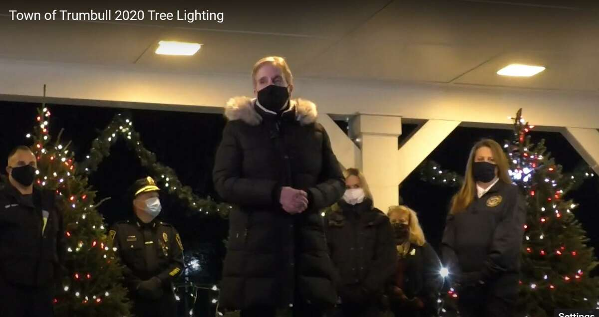 Town officials prepare to turn on the Christmas lights at Town Hall Gazebo.