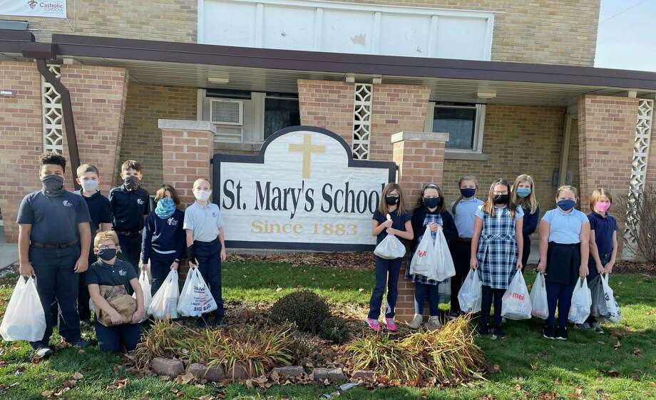 Pictured are St. Mary Catholic School students who recently completed a challenge to collect 1,000 items to donated to the Manna Pantry of Big Rapids. In exchange, the parent who challenged students also donated 1,000 items to the pantry. (Courtesy photo)
