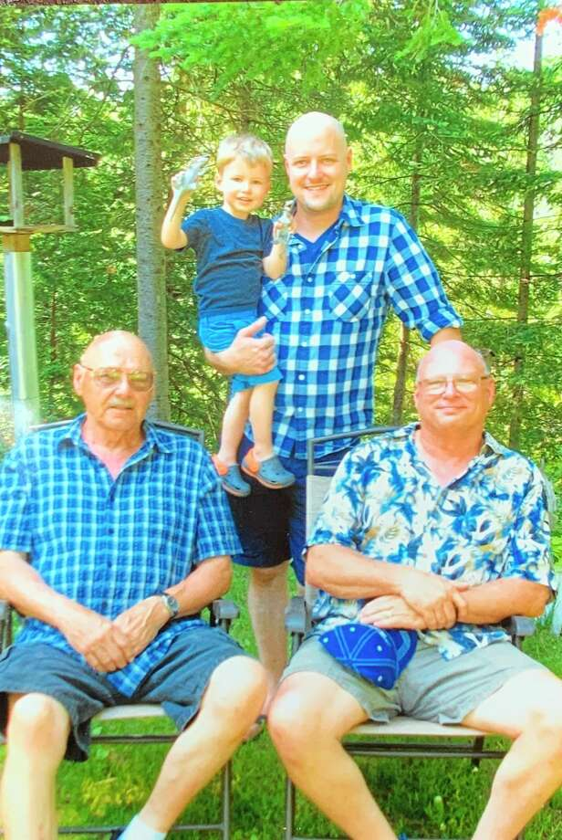 """This is a Father's Day photo of the Holzhausen men. In front are Bob (father) and son Jeff. Standing the back is Jeff's son Ben holding his son Landon. Of her family, Pat said, """"We have been blest beyond measure."""" (Photo provided)"""