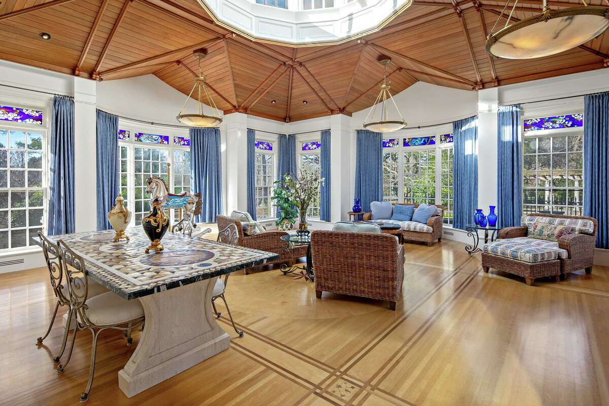 English conversatory with glass dome and stained glass transoms at 1211 Old Academy Road, Fairfield. Inside the 7,635-square-foot, 13-room cream-colored colonial main house - which was built in 1948- there is a custom home movie theater