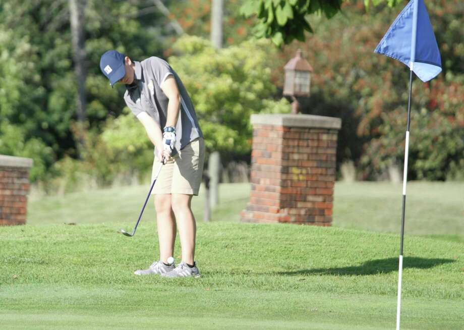 Trista Arnold, a 2020 Manistee High School Graduate, chips onto the green at the Manistee Golf and Country Club during her senior season. Arnold went to Missouri Valley College to continue her golf career and made the Fall 2020 Dean's List as an exercise science major. (File photo)
