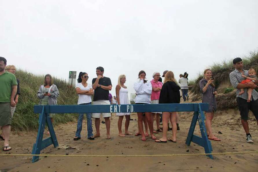 MONTAUK, NY - SEPTEMBER 03: People watch the beach which is closed to swimming due to Hurricane Earl