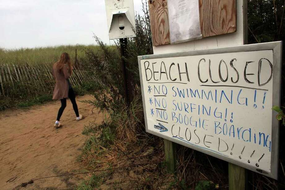 MONTAUK, NY - SEPTEMBER 03: A sign announces that the beach is closed to recreational activities due to Hurricane Earl on September 3, 2010 in Montauk, New York. Much of New England is preparing for Hurricane Earl, now a category 1 storm with sustained winds of 85 miles per hour. While current projections are that Earl will continue to weaken as it moves over cooler waters, it still described as a dangerous storm and the largest to make it into the New York City region since Hurricane Bob in 1991.  (Photo by Spencer Platt/Getty Images) Photo: Spencer Platt, Getty Images / 2010 Getty Images