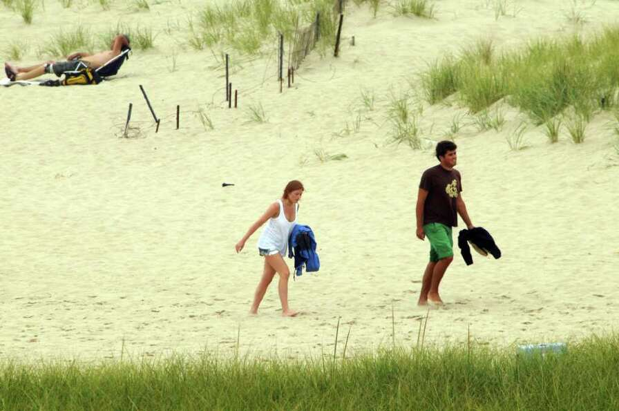CHATHAM, MA -  SEPTEMBER 3:  People walk the shore along Chatham Beach while waiting for Hurricane E