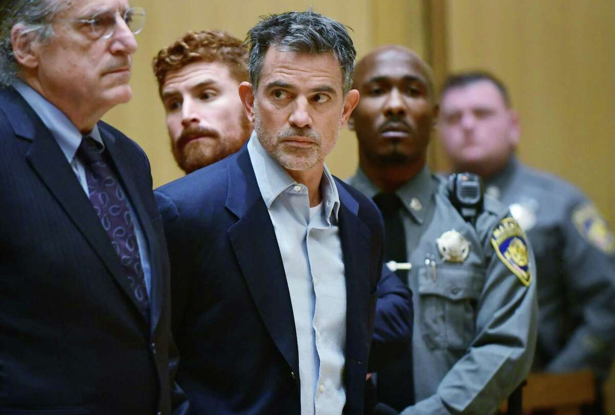Fotis Dulos is arraigned on murder and kidnapping charges in Stamford Superior Court Wednesday, Jan. 8, 2020, in Stamford, Conn. Dulos had been previously charged with evidence tampering in the disappearance of his wife, Jennifer Dulos.