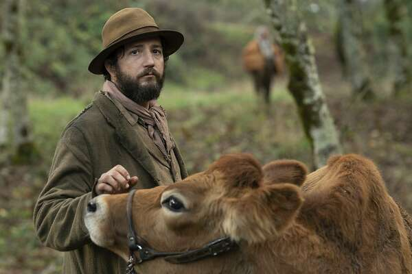 "This image released by A24 shows John Magaro in a scene from the film ""First Cow."" (Allyson Riggs/A24 via AP)"