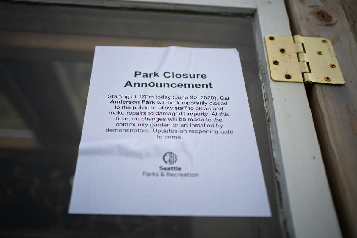 SEATTLE, WA - JUNE 30: A leaflet containing messages about the parks closure is seen on a greenhouse created by protesters in their garden area in Cal Anderson Park in the Capitol Hill Organized Protest (CHOP) zone on June 30, 2020 in Seattle, Washington.