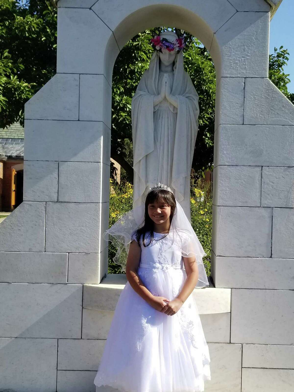 St. Mary School students made their First Holy Communion Oct. 3 in St. Mary Church in Milford. Students were supposed to make the sacrament in May, but due to the pandemic, it had to be rescheduled.