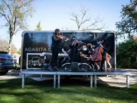 From left, members of the Agarita chamber ensemble Sarah Silver Manzke, Marisa Bushman and Ignacio Gallego Fernandez perform at the Witte Museum. They performed in front of the Humble Hall, a travel trailer that will enable them to stage free outdoor concerts all over the city.