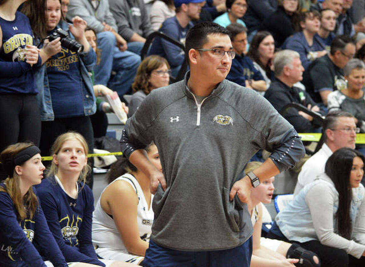 Father McGivney athletic director and girls basketball coach Jeff Oller paces the sideline during a game last season.