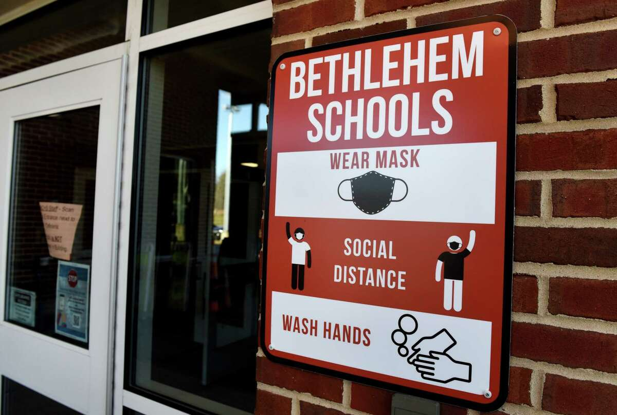 A coronavirus safety sign is posted at an entry to Bethlehem High School on Tuesday, Dec. 15, 2020, in Bethlehem, N.Y. (Will Waldron/Times Union)