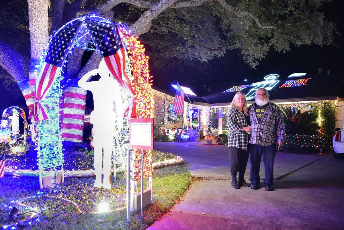 Nancy and Rico Sardelli pose in front of their decorated home during the Windcrest Light Up event. The couple begins decorating their house each year in October.
