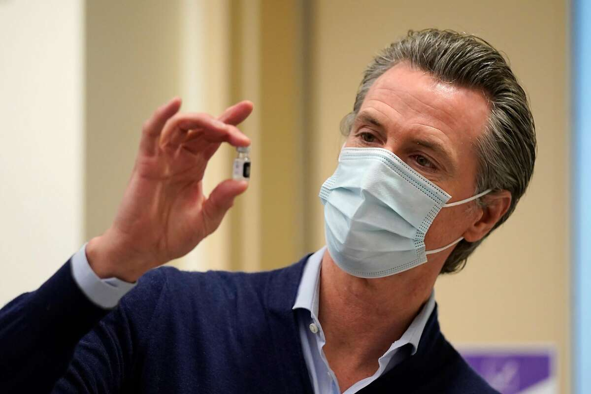 Gov. Gavin Newsom, seen with a vaccine vial in December, says everyone 16 and up will be eligible for a coronavirus vaccination in California starting April 15.
