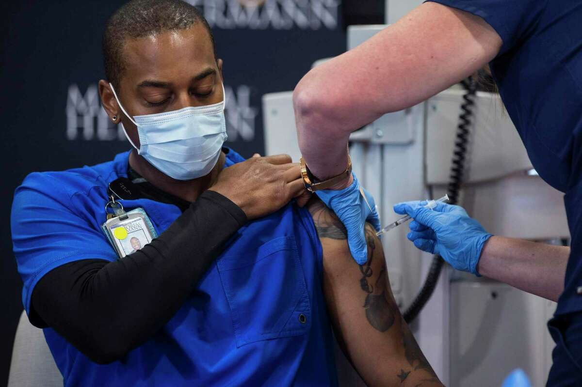 Robert Luckey, COVID ICU Nurse, receives a dose of the Pfizer Covid-19 vaccination at Memorial Hermann Hospital in the Texas Medical Center Tuesday, Dec. 15, 2020 in Houston. Front line workers at Memorial Hermann were some of the first to receive the recently approved vaccine. The Pfizer vaccine was almost 95 percent effective at preventing patients from contracting COVID-19 and caused no major side effects in a trial of nearly 44,000 people.