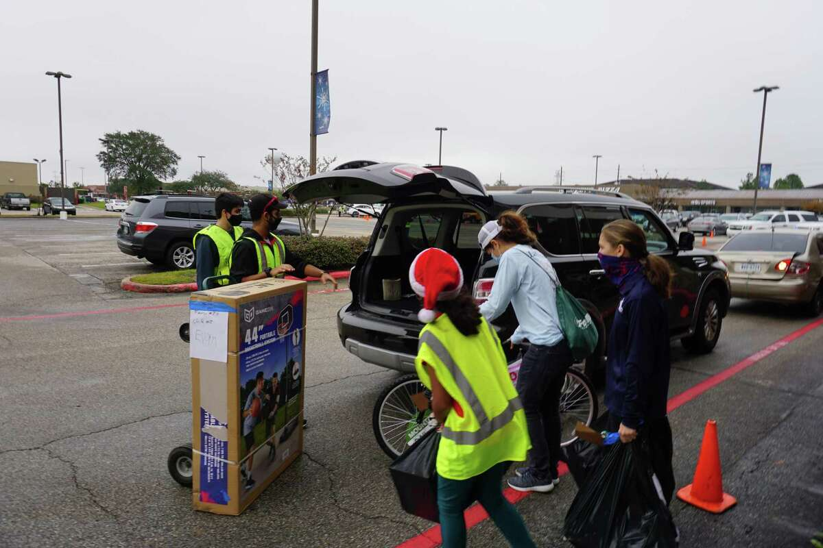Volunteers load Christmas gifts at the distribution event for Santa's Sleigh on Saturday, Dec. 12. The Katy Christian Ministries program provided presents to nearly 1,100 Katy-area children and senior adults.