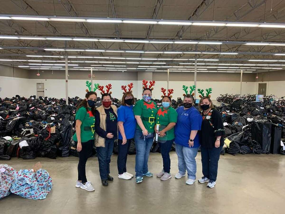 Part of the Katy Christian Ministries Santa's Sleigh team poses at the distribution event in Katy on Friday, Dec. 11. The event distributed Christmas gifts to nearly 1,100 children and senior adults.