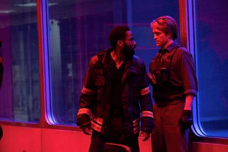 """John David Washington, left, and Robert Pattinson meet each other coming and going in """"Tenet."""""""