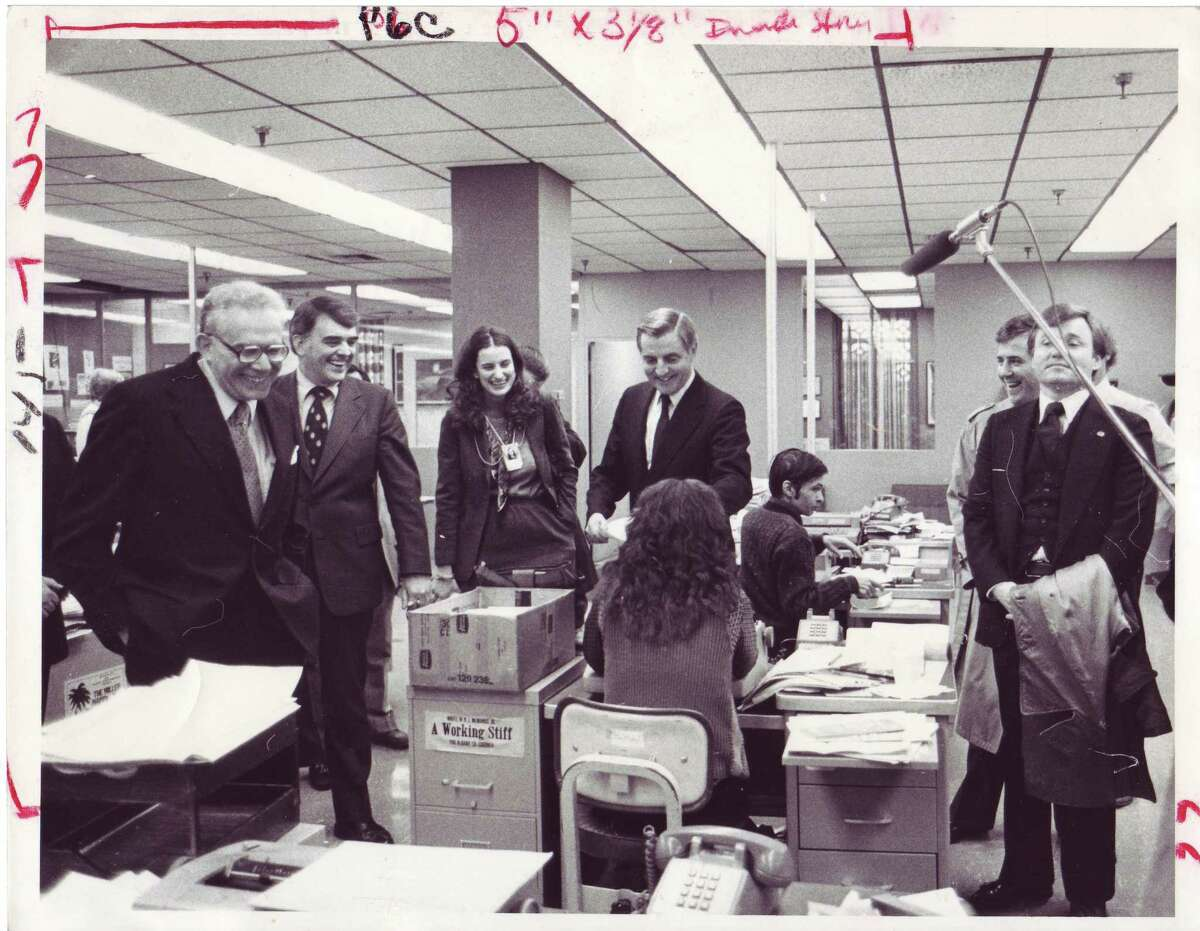 Vice President Walter Mondale, center, shakes hands with Times Union reporter Carol DeMare (with back to camera) during a visit to the Times Union in 1980 as he and then-president Jimmy Carter were waging what would be an unsuccessful re-election bid. From left are Editor Harry Rosenfeld, Publisher Roger Grier, Knickerbocker News Reporter Lise Bang-Jensen, Mondale with DeMare, Editorial Assistant Ken DelSanto and two unidentified Secret Service personnel. (Times Union / Jack Pinto)