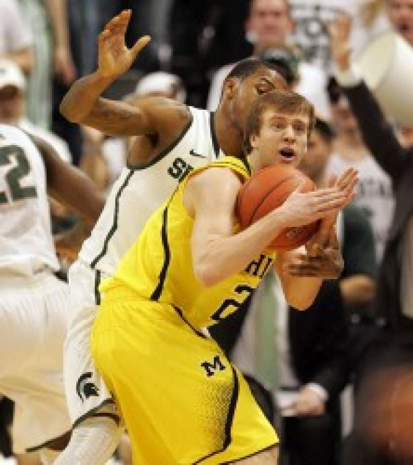 Michigan guard Spike Albrecht (right) calls a timeout while being defended by Michigan State guard Keith Appling during the Spartans' lopsided win in East Lansing on Tuesday. Photo: Associated Press, File