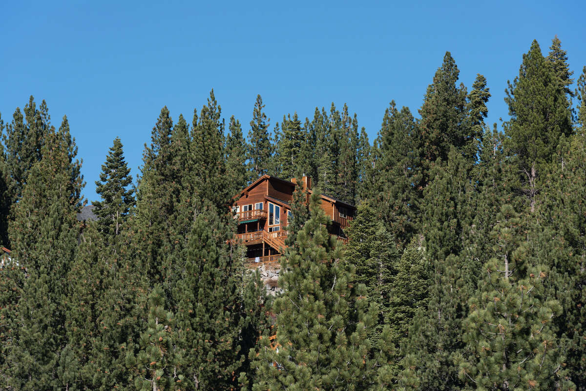 File photo of a house nestled in the trees in Truckee, Calif.