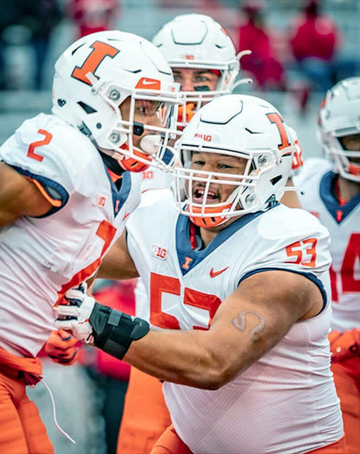 Illinois offensive lineman Kendrick Green (53) celebrates with running back Chase Brown (2) after Brown scored a touchdown Nov. 22 at Nebraska. Both players were named All-Big 10 Tuesday. Photo: Michael Glasgow   Illinois Athletics
