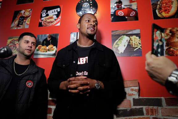 Sam Berry, left, Detroit based company founder, and Deshaun Watson, right, Texans quarterback and new restaurant owner speak during a press conference on the grand opening of the new Lefty's Cheesesteaks, Hoagies and Grill Tuesday, Dec. 15, 2020 near NRG Stadium in Houston, TX.
