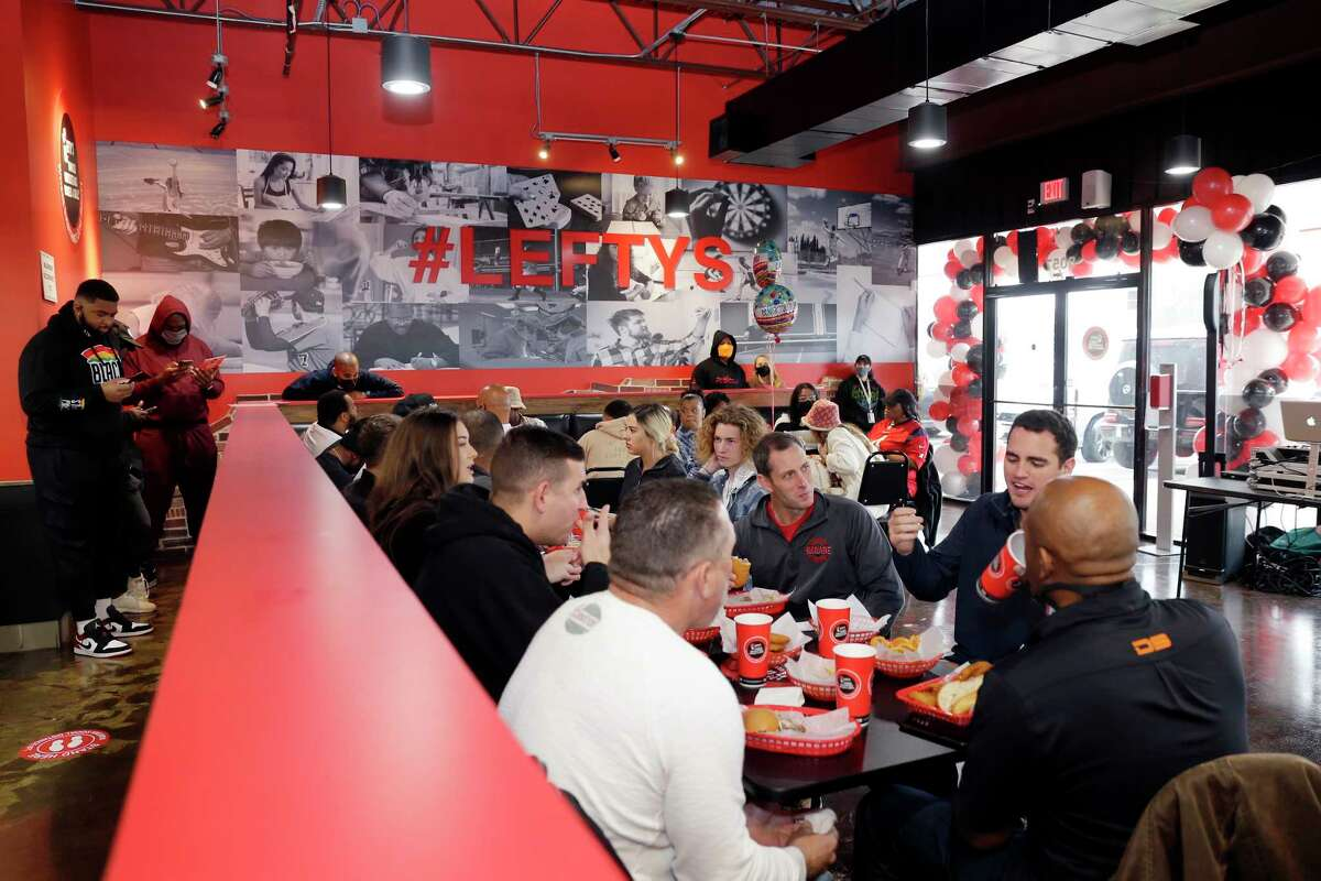 Customers, friends and family - including Texans offensive tackle Tytus Howard on the far left - in the dining area during the grand opening of the new Lefty's Cheesesteaks, Hoagies and Grill Tuesday, Dec. 15, 2020 near NRG Stadium in Houston, TX.