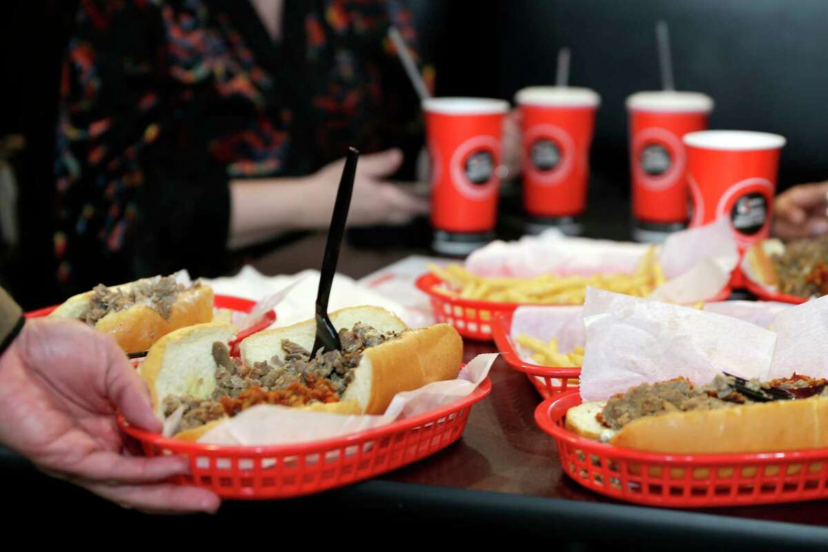 Cheesesteaks and drinks at customer tables during the grand opening of the new Lefty's Cheesesteaks, Hoagies and Grill Tuesday, Dec. 15, 2020 near NRG Stadium in Houston, TX.
