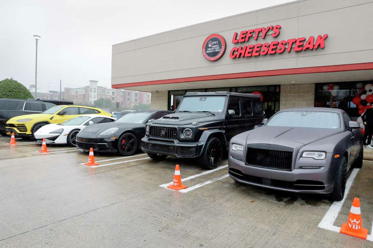 High end cars in VIP spaces in the parking lot outside the main entrance during the grand opening of the new Lefty's Cheesesteaks, Hoagies and Grill Tuesday, Dec. 15, 2020 near NRG Stadium in Houston, TX.