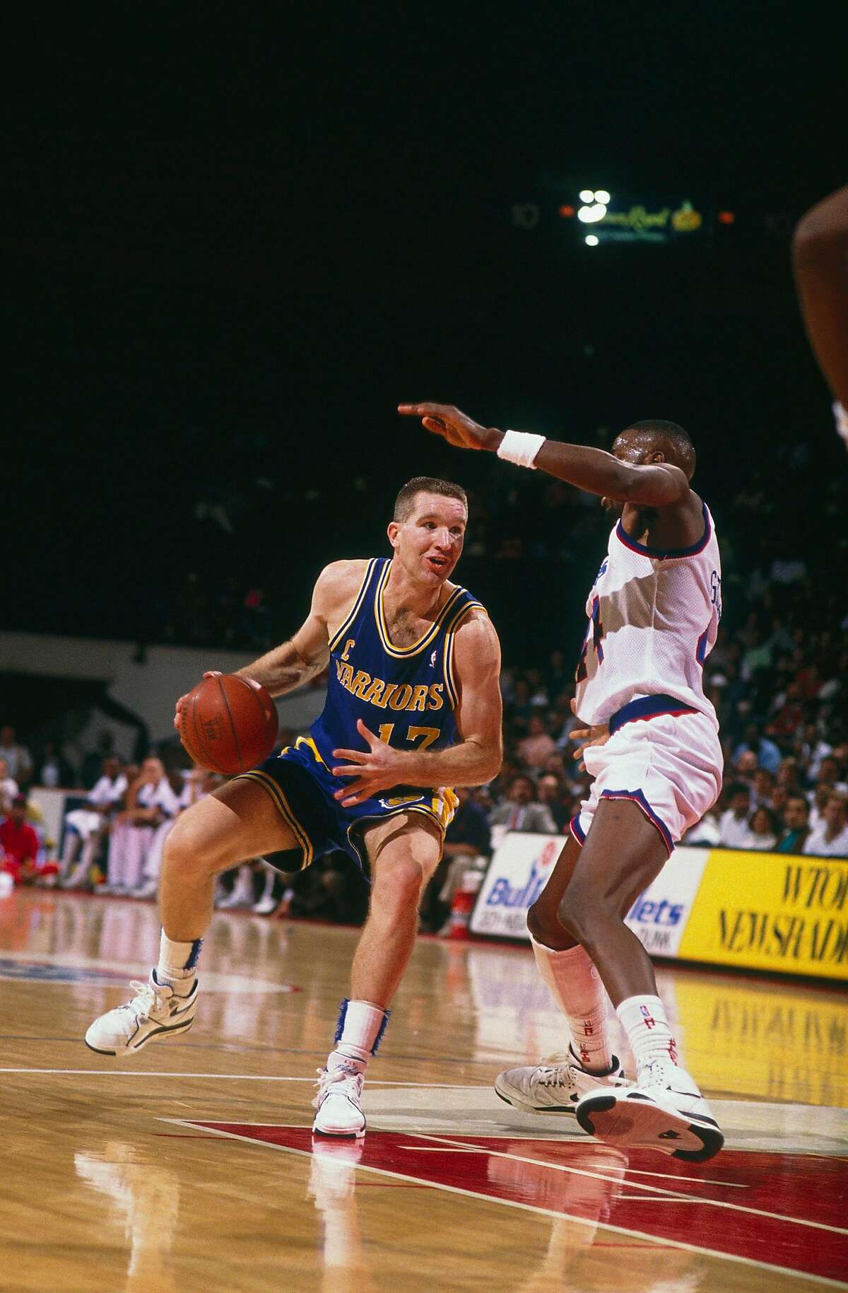 WASHINGTON - UNDATED: Golden State Warriors' forward Chris Mullin #17 dribbles downcourt against the Washington Bullets at Capital Center circa the 1990's in Washington, D.C.. NOTE TO USER: User expressly acknowledges and agrees that, by downloading and/or using this Photograph, user is consenting to the terms and conditions of the Getty Images License Agreement. (Photo by Focus on Sport/Getty Images)