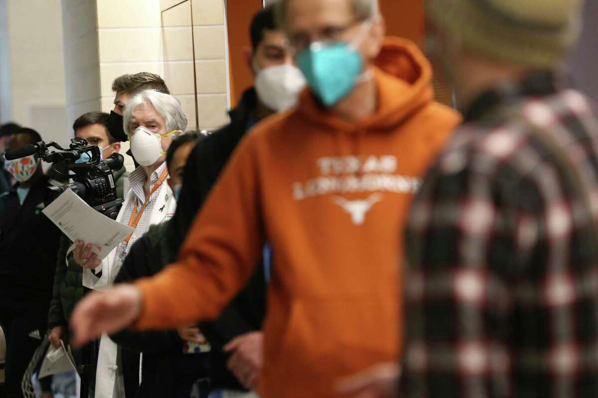 Medical staff wait in line to get their Pfizer COVID-19 vaccine at Dell Medical School at UT Austin, Tuesday, Dec. 15, 2020. Three hundred people were expected to get their first of two vaccines today.