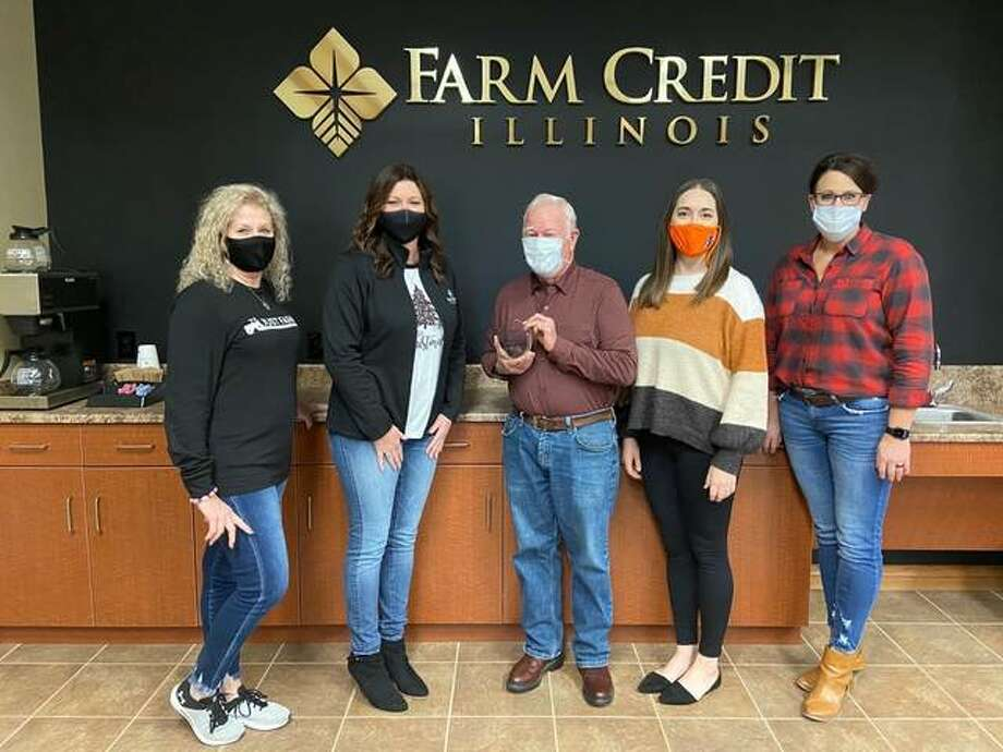 Farm Credit Illinois of Jerseyville recently received the 2020 Community Partner Award. Pictured from left are Judi Neese, Member Service Specialist; Hollie Nixon, Regional Manager; Jack Stork, Extension Council Chairman; Jessica Jaffry, 4-H & Youth Development Program Coordinator; and Jackie Goode, Loan Process Specialist.
