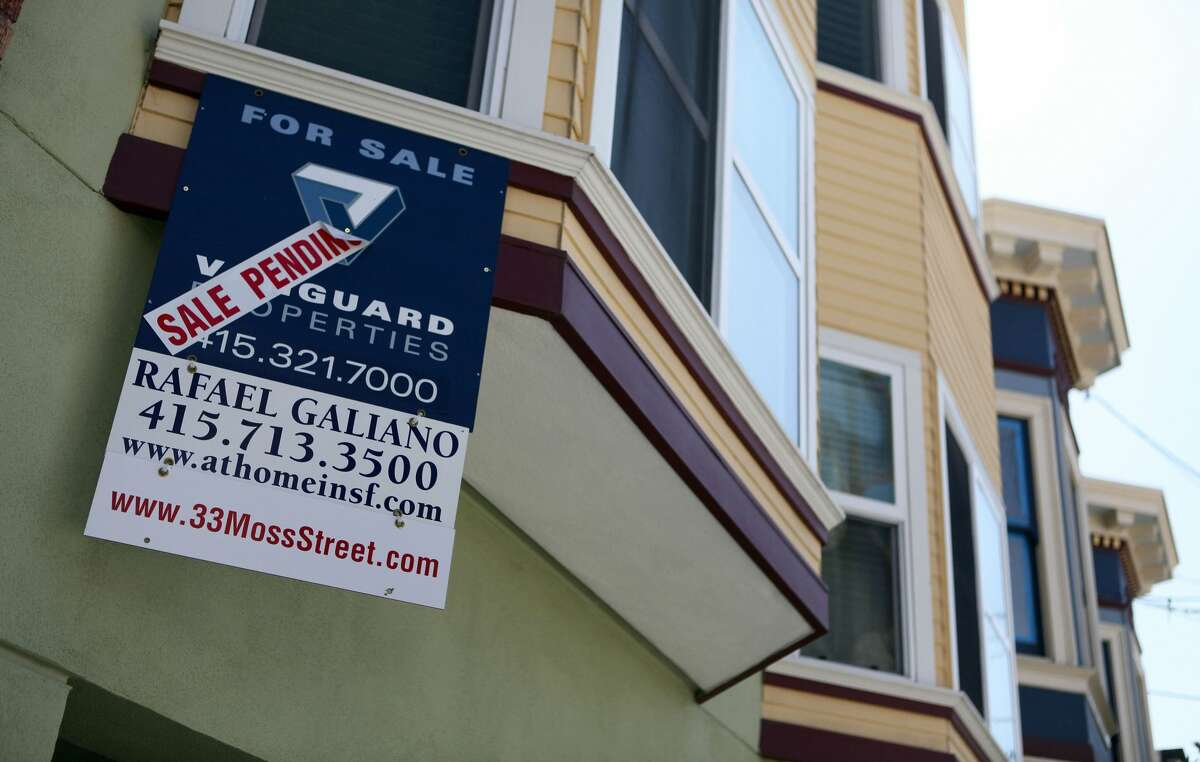 In this file photo, a sale pending sign is posted in front of a home for sale in San Francisco.
