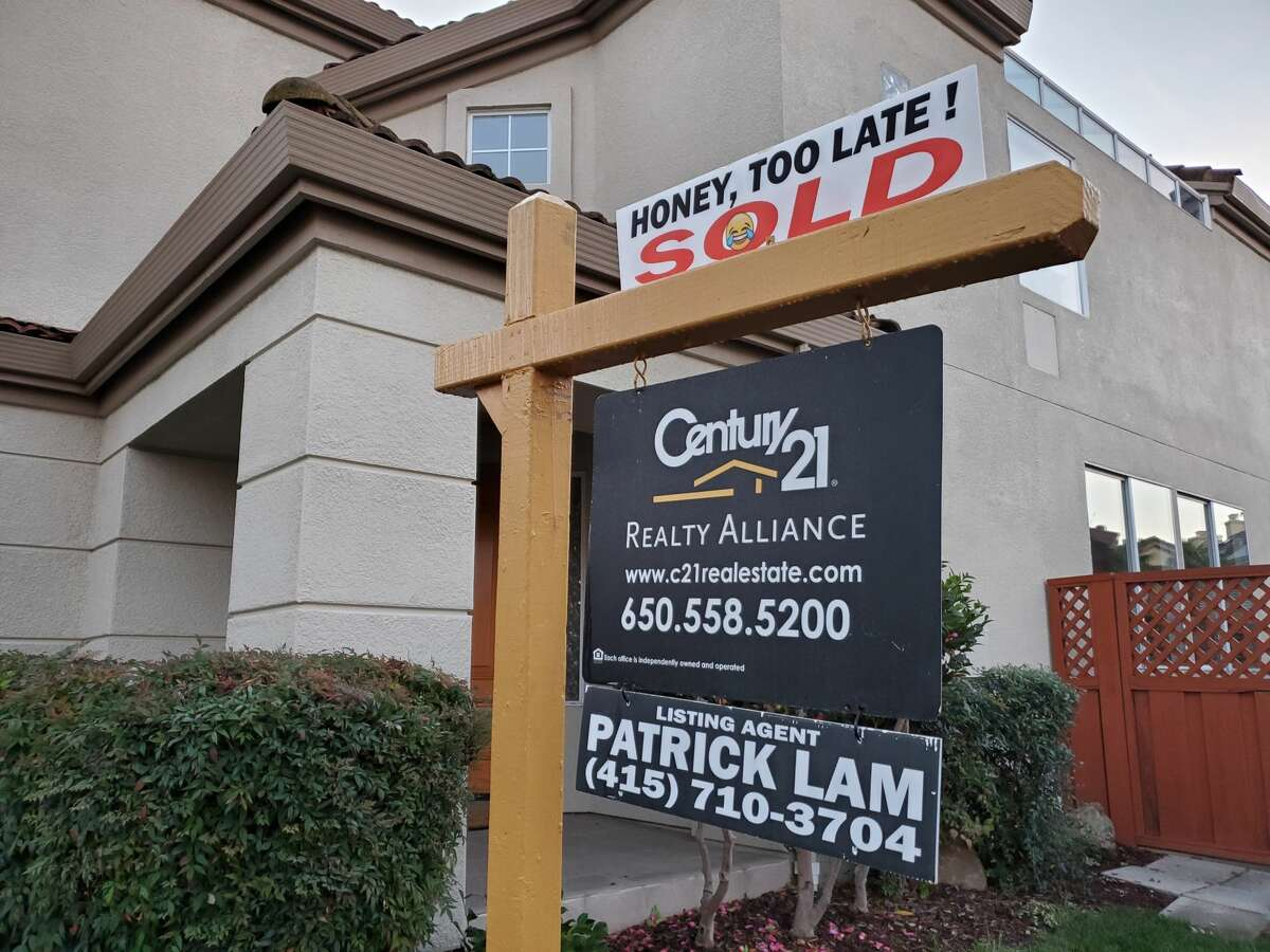 In this file photo, a realty sign in front of home for sale.