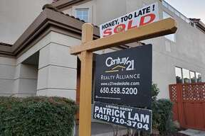 In this file photo, a realty sign in front of home for sale in San Ramon, California.